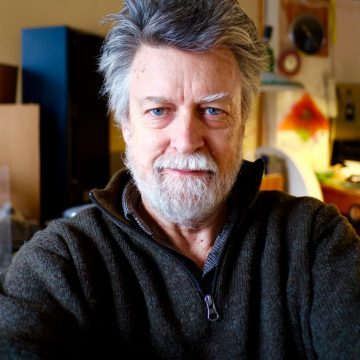 Asheville glass artist Carl Powell in his Grovewood Village studio.