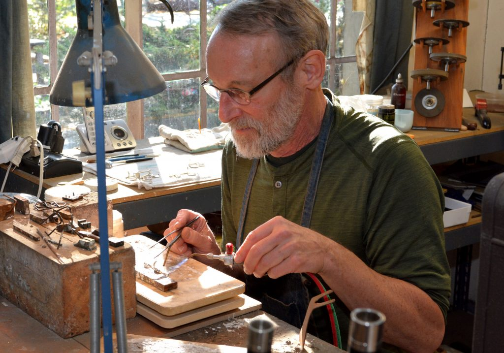 Wooden flutemaker Chris Abell working in his Grovewood Village studio in Asheville.