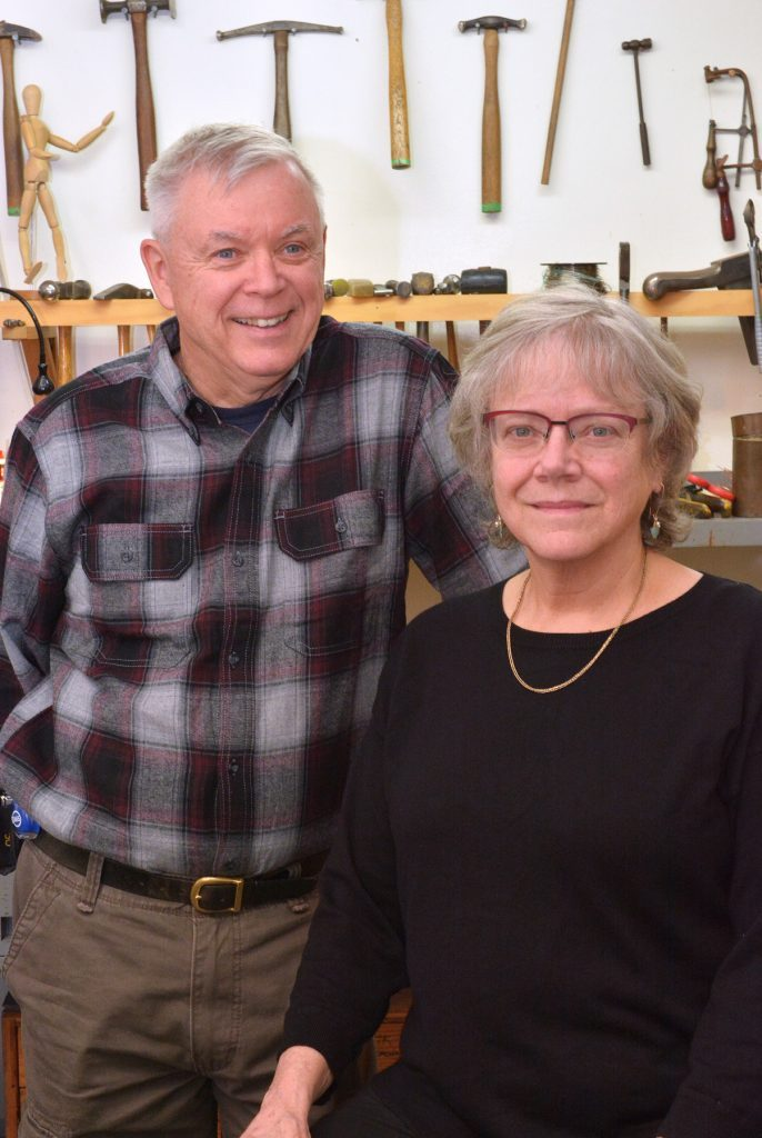 Asheville metalsmiths Tom Reardon and Kathleen Doyle in their Grovewood Village studio.