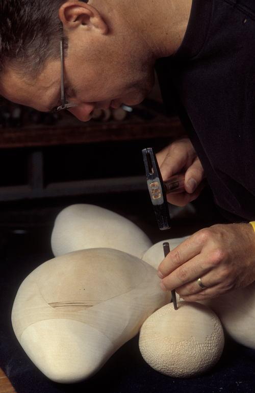 Fine furniture maker Brent Skidmore working in his Grovewood Village studio.