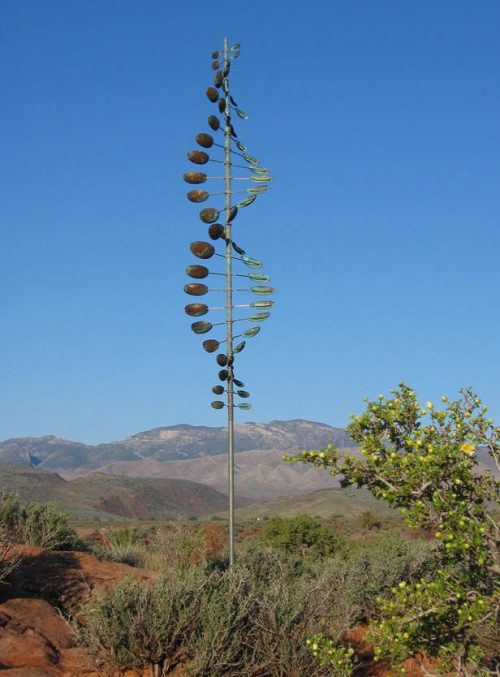 Lyman Whitaker Wind Sculptures titled Bean Pole set in a mountain setting.
