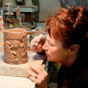 Ceramic artist Helen Purdum working in her Grovewood Village studio in Asheville.