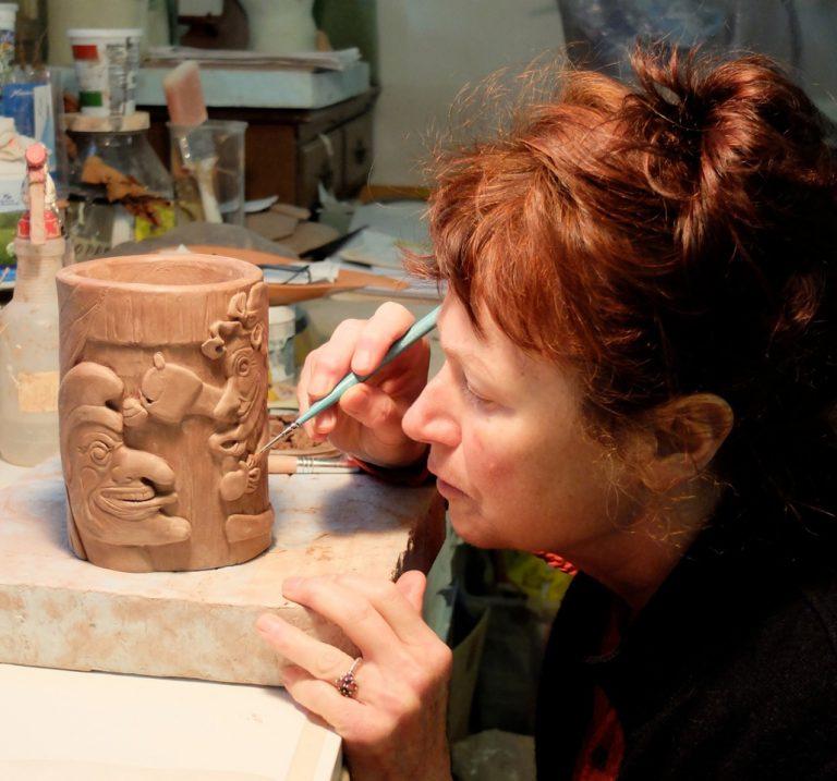 Ceramic artist Helen Purdum working in her Grovewood Village studio in Asheville.