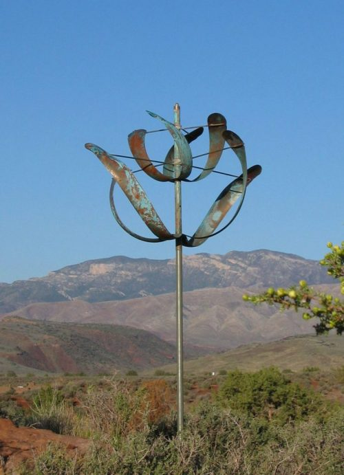 Windflower Wind Sculpture by Lyman Whitaker in a mountain setting.