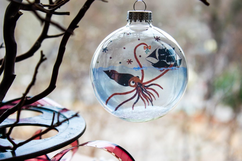 Artisan-made glass ornament available at Grovewood Gallery during their Holiday Sip & Shop.