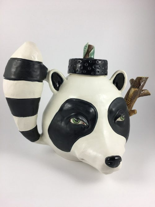 Decorative raccoon teapot by ceramic artist Taylor Robenalt available at Grovewood Gallery.