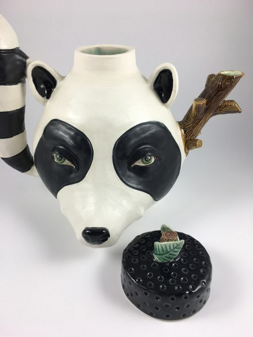 Decorative porcelain raccoon teapot by artist Taylor Robenalt.
