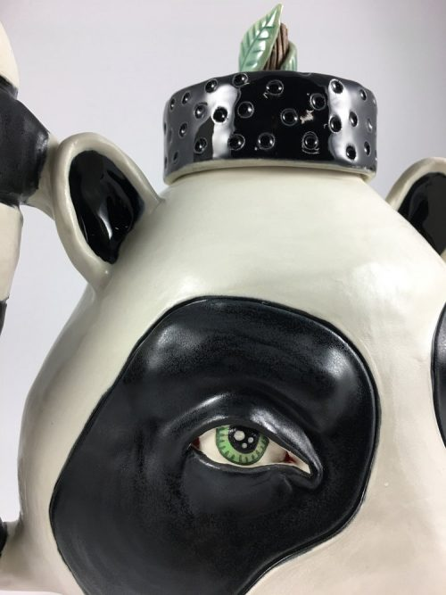 Detail of artisan-made raccoon teapot by ceramic artist Taylor Robenalt.