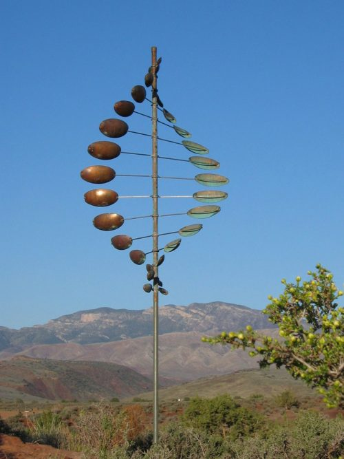 A double helix horizontal wind sculpture by Utah artist Lyman Whitaker.