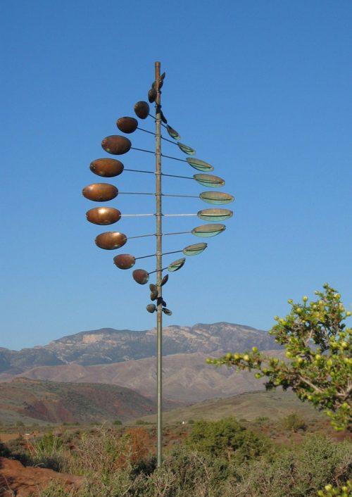 A double helix horizontal wind sculpture by Utah artist Lyman Whitaker.