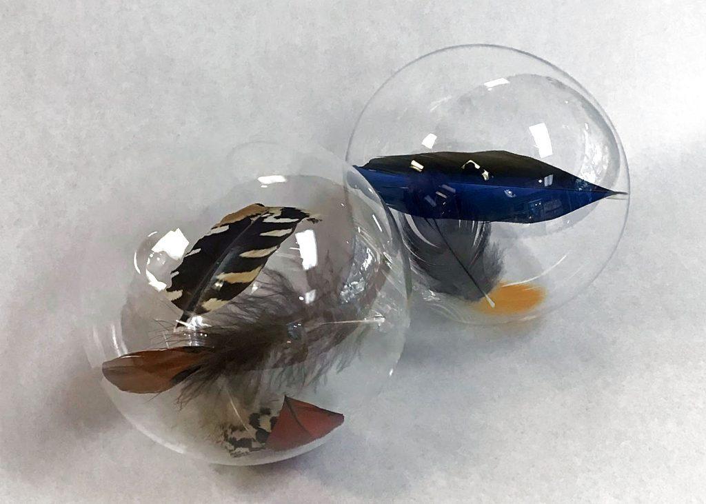 Glass feather balls by artist Kyle Keeler.