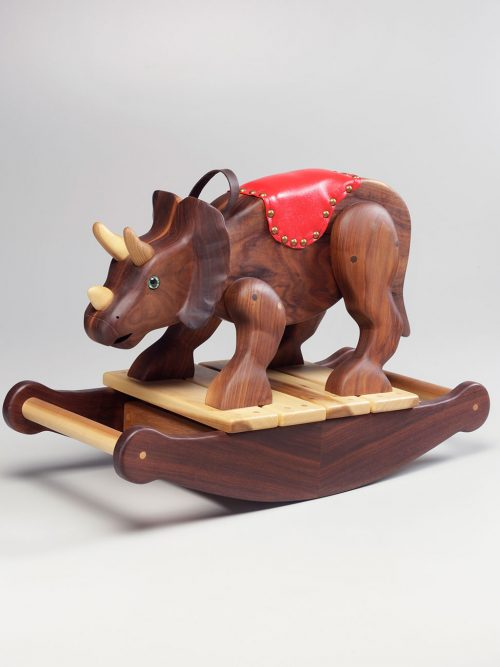 Wooden triceratops toddler rocker handcrafted by Asheville artist Alicia Williams.