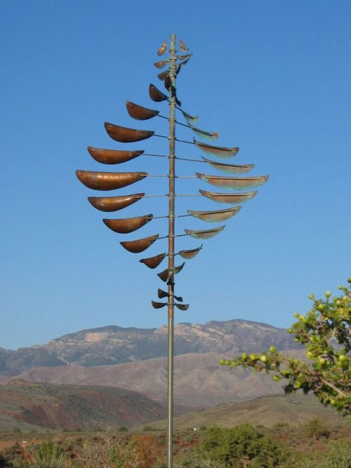 Double Helix Sail Wind Sculpture by Lyman Whitaker in a mountain setting.