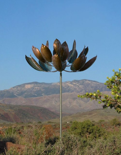 Lotus Wind Sculpture by Lyman Whitaker in a mountain setting.