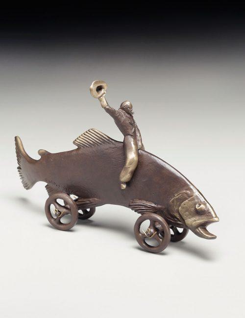 Bonze sculpture of a cowboy riding a trout.