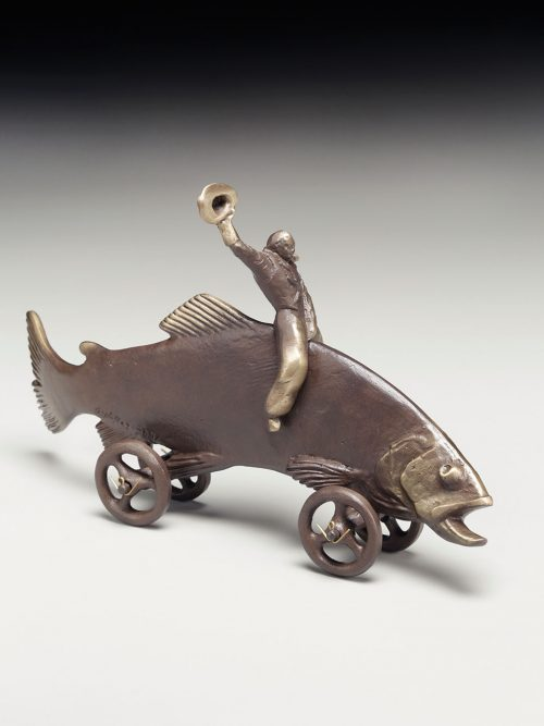 Bonze sculpture of a cowboy riding a trout.
