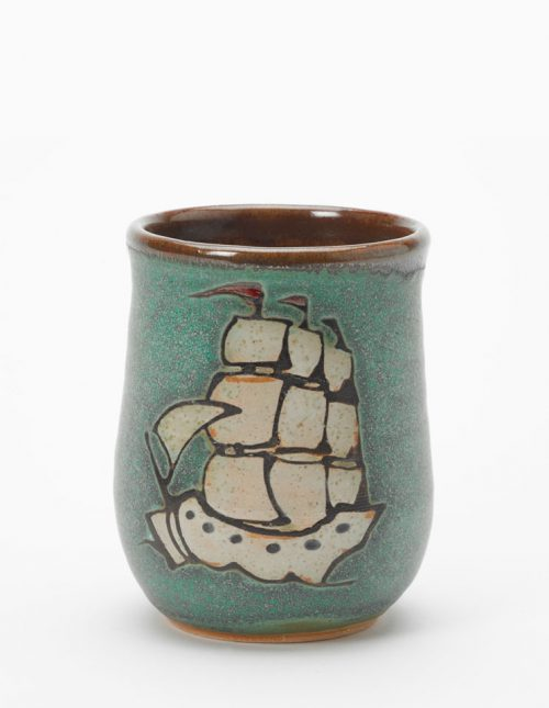 Ceramic cup handmade by Hog Hill Pottery featuring Blackbeard's ship the Queen Anne's Revenge.