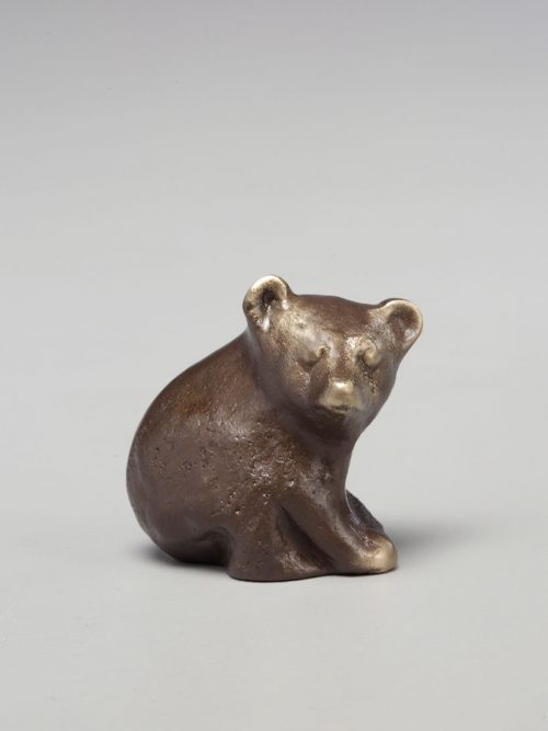 Cast bronze bear cub sculpture by Scott Nelles.