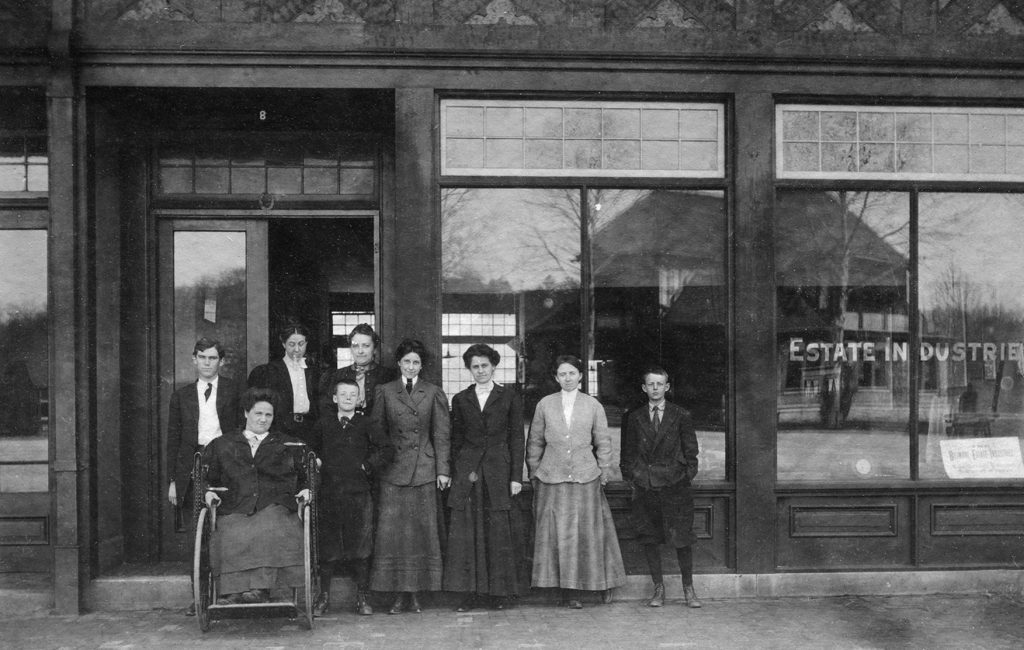 Standing in the doorway, left to right, Charlotte Yale and Eleanor Vance in front of Biltmore Estate Industries.