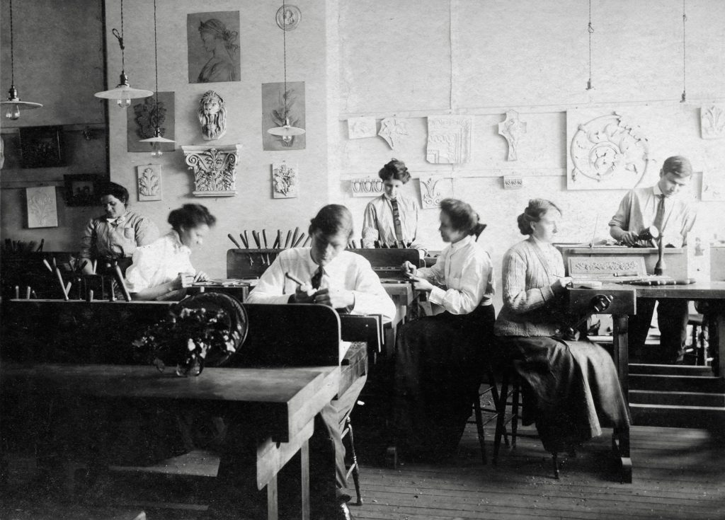 Archival photo of the woodcarving shop at Biltmore Estate Industries in Asheville, NC.
