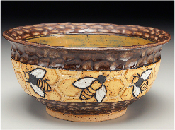 Ceramic bee bowl available for sale at Gallery of the Mountains in Asheville.