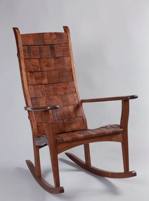 Walnut rocking chair with a rope block design handcrafted by Alan Daigre.