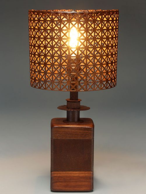 Table lamp with decorative metal shade by Asheville artist Kim Dryden.