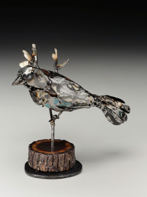 Upcycled metal sparrow sculpture by North Carolina artist Mel Bennett.