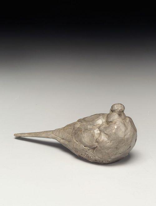 Small bronze dove sculpture by North Carolina artist Roger Martin.