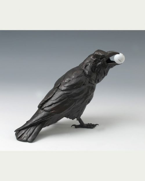 Bronze crow with a golf ball in its mouth by North Carolina wildlife sculptor Roger Martin.
