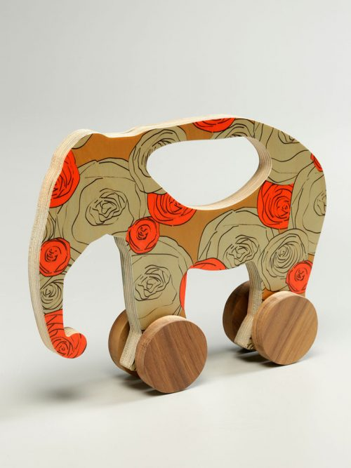 Wooden elephant push toy with graphic print by Wolfum.