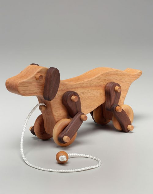 Pull dog toy handcrafted from white oak and walnut by East Laurel Woodcrafts.