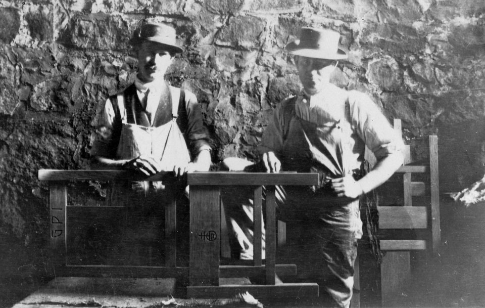 Two Roycroft artisans posed with a chair they made for the Grove Park Inn. in Asheville