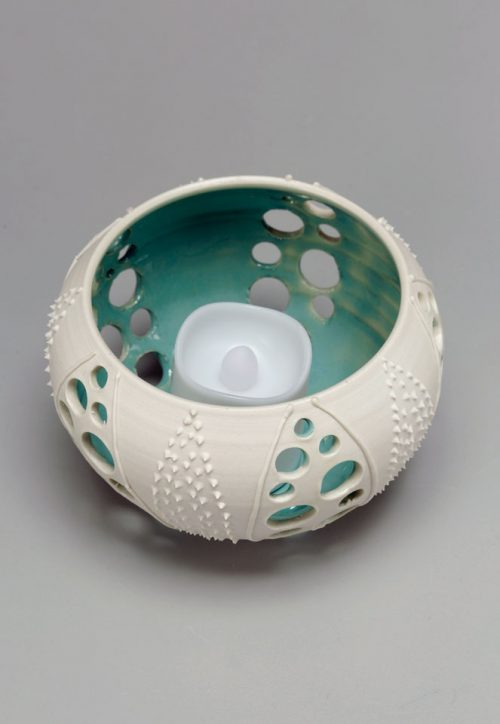 Porcelain sea urchin votive by Asheville potter Anja Bartels.