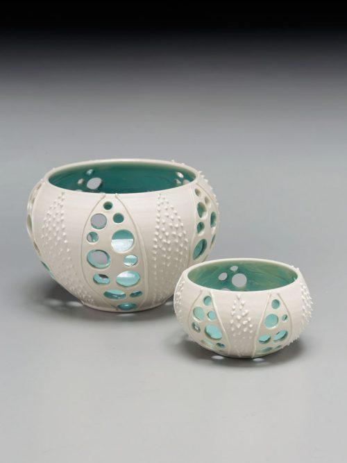 Porcelain sea urchin votives by Asheville potter Anja Bartels.