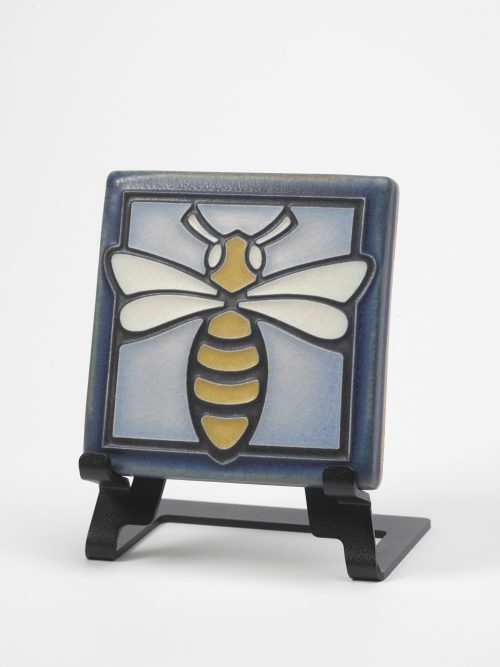 Light blue ceramic bee tile by Motawi Tileworks.