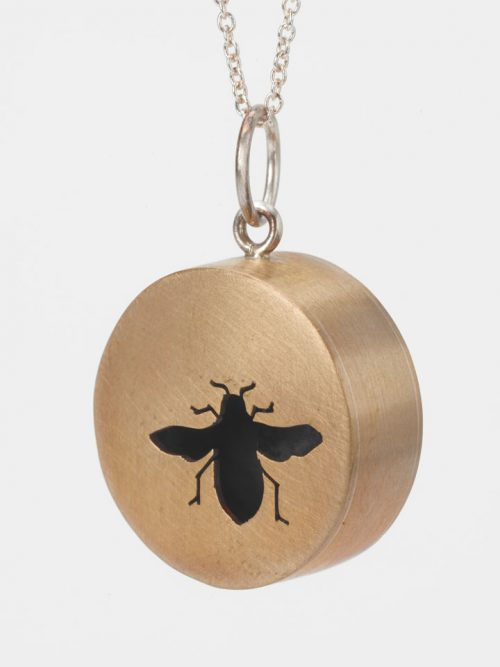 Brass shadow box bee necklace by North Carolina artist Audrey Laine.