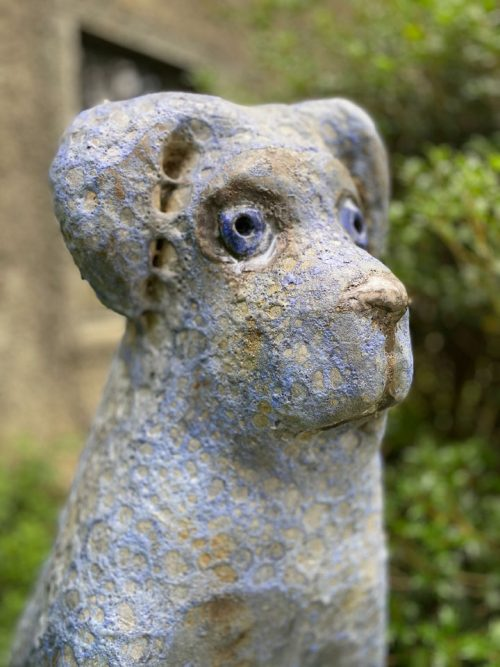 Detail of a big blue dog sculpture by Mark Chatterley.