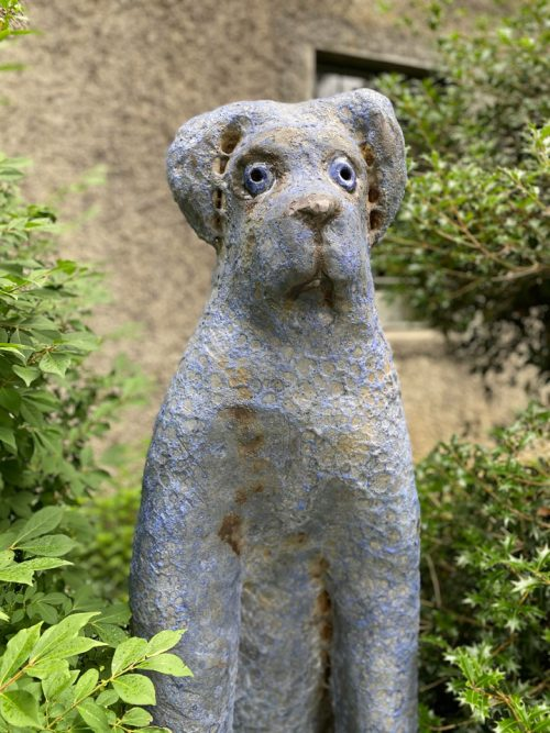 Detail of a ceramic big blue dog sculpture by Mark Chatterley.