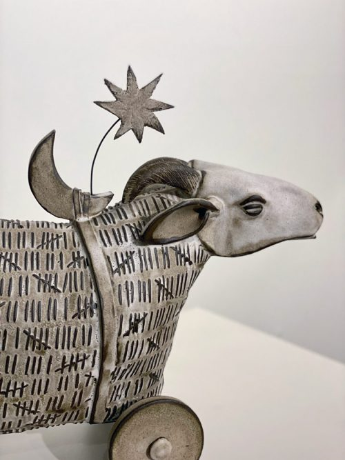 Ceramic sculpture of a sheep by Libba Tracy.
