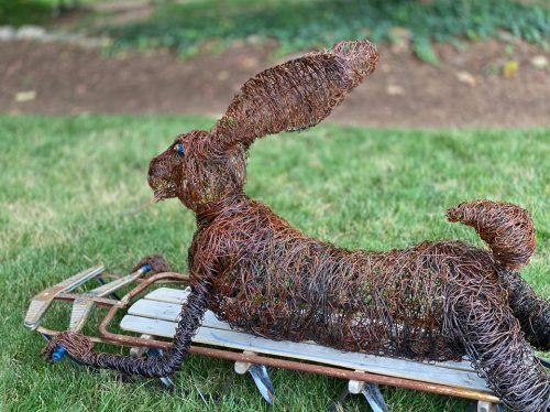 Wire sculpture of a hare on a sled by Josh Cote.