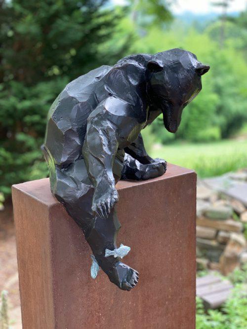 Bronze black bear sculpture by Roger Martin.