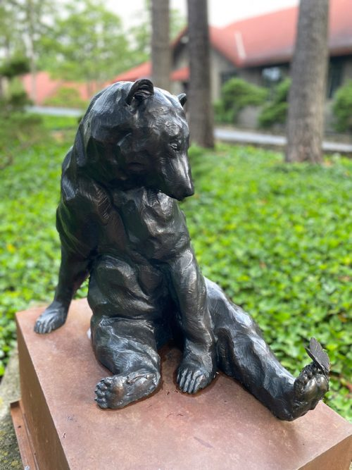 Bronze sculpture of a black bear by Roger Martin.