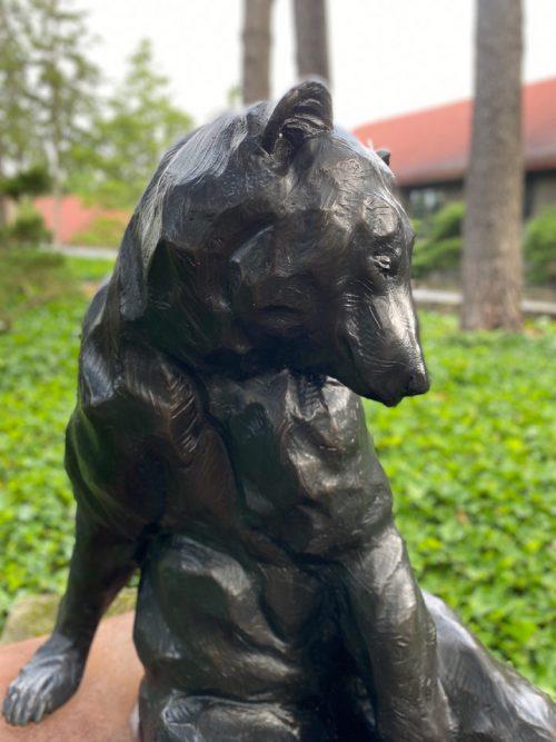 Fine art outdoor sculpture of a black bear by Roger Martin.