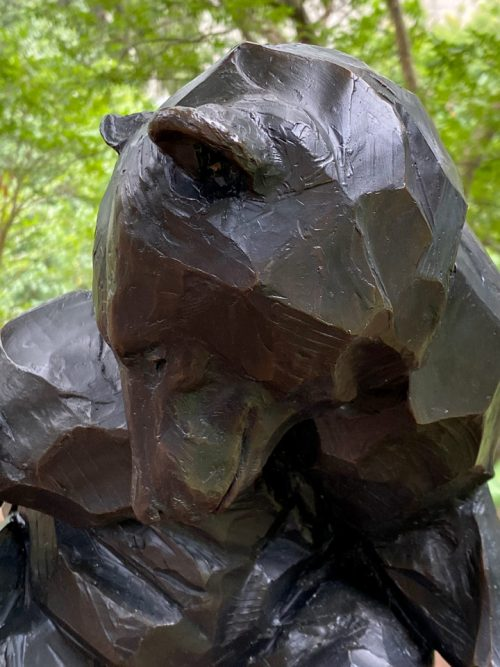 Detail of a bronze black bear sculpture by Roger Martin.