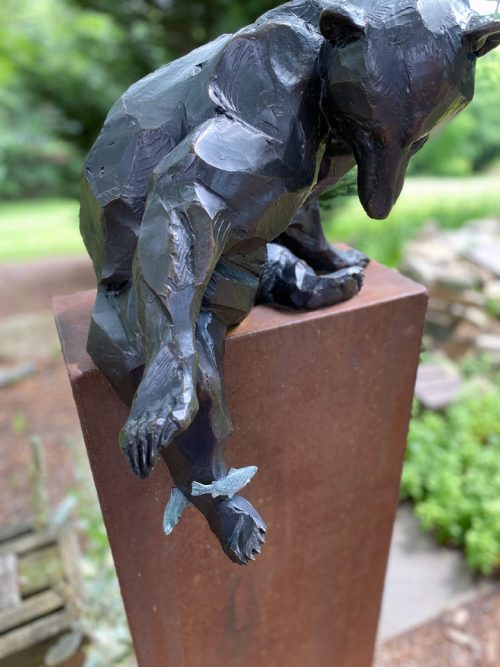 Detail of a bronze black bear sculpture by Roger Martin.