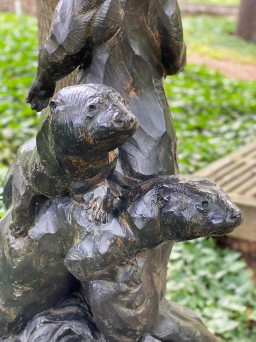 Bronze sculpture of otters by Roger Martin.