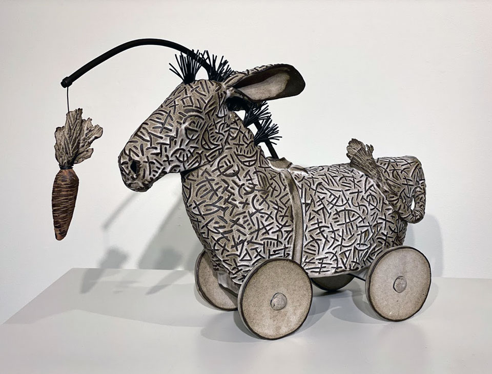 """Ceramic sculpture titled """"Chasing the Carrot"""" by Libba Tracy."""