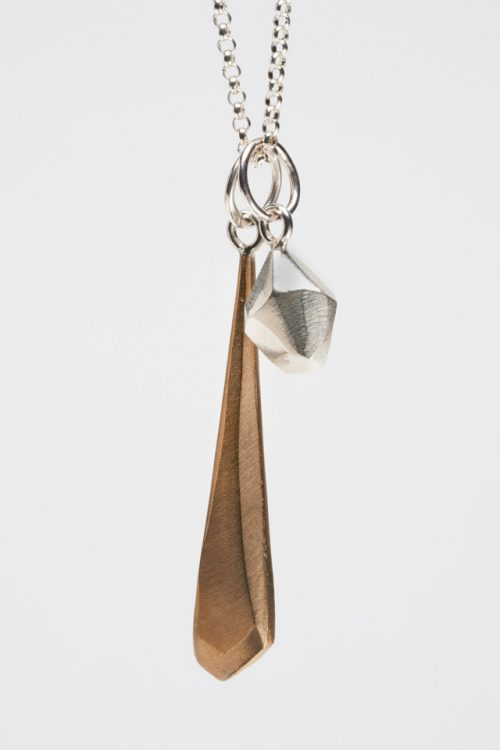 Silver and bronze faceted dagger pendant by North Carolina metalsmith Audrey Laine.