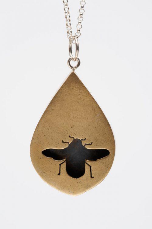 Audrey Laine teardrop shadow box necklace in bronze.